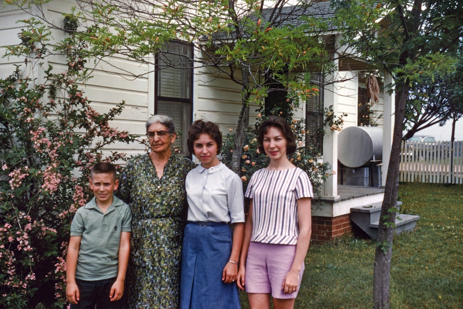 My brother, sister and I with our grandmother at her place (in the late 50s or early 60s)