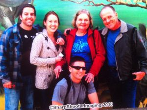 From L to R: Younger son Darcy, his wife Jacqui, Roberta, Patrick and older son Peter (lower center)